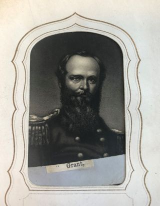 COLLECTION OF FORTY-EIGHT SMALL PORTRAIT ENGRAVINGS OF UNION AND CONFEDERATE LEADERS IN CARTE-DE-VISITE FORMAT, INSERTED INTO A PERIOD ALBUM.